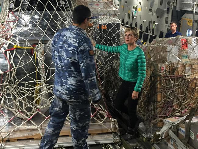 Bishop inspects pallets and packages of Australian aid on a C17 bound for Fiji. Picture: AAP Image/Rashida Yosufzai.