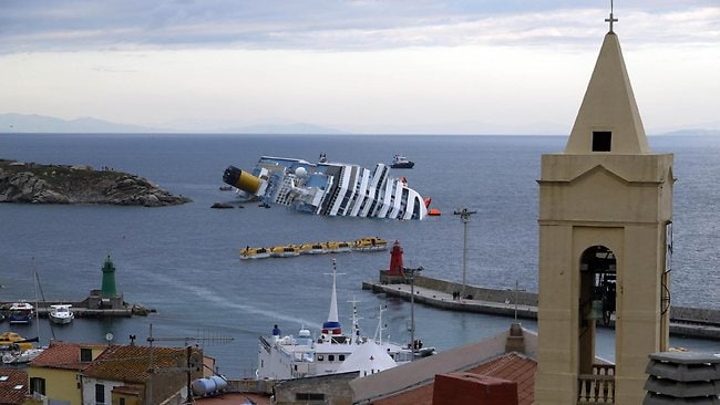 The Costa Concordia cruise ship lies in the harbour of the Tuscan island of Giglio.