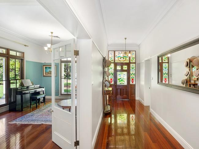 Lovely dark hardwood floors, cedar windows and stained glass doors are just a few of the outstanding features on offer. Picture: McGrath Terrigal