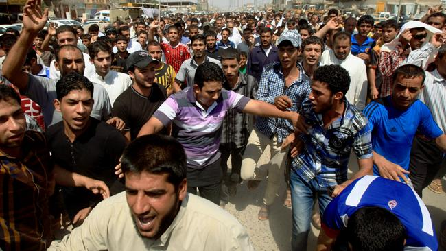 Followers of Shiite cleric Muqtada al-Sadr chant slogans against the U.S. during a demonstration in Basra, 340 miles (550 kilometres) southeast of Baghdad, Iraq, Friday, Aug. 30, 2013. Followers of Shiite cleric Muqtada al-Sadr held rallies in Baghdad and the southern Iraqi city of Basra to denounce any Western strikes against Syria. (AP Photo/Nabil al-Jurani)
