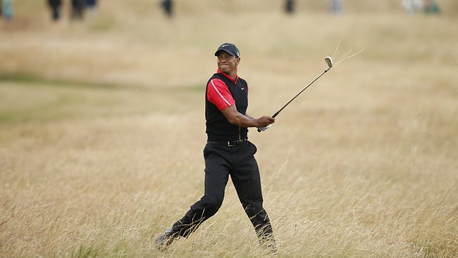 Tiger Woods plays a shot out of the rough on the 10th hole during the final round of the British Open Golf Championship at Muirfield.