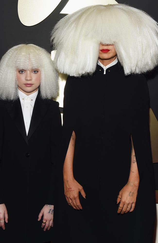 What the? ... Dancer Maddie Ziegler and singer/songwriter Sia (right) arrived looking like this!