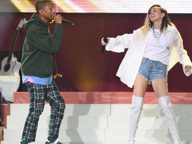 Pharrell Williams and Miley Cyrus team up for 'Happy'. Picture: AP