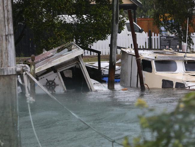 Boats are sinking in Wynnum Creek as storms hit Brisbane. Picture: Darren England