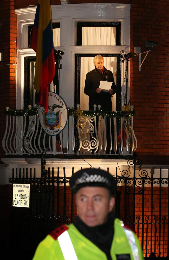 A policeman watches the crowd as WikiLeaks founder Julian Assange speaks from the Ecuadorean Embassy in London in 2012. Picture: Peter Macdiarmid/Getty Images