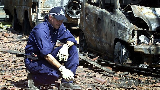 Australian Federal Police officer Jim Pearson was among the forensic team hunting for evidence at the sight of the bomb blast in Kuta, Bali. Picture: Herald Sun