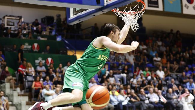 Australia's Mitchell McCarron dunks during the FIBA Asia Cup 2017 final game against Iran. Picture: AP Photo/Hussein Malla