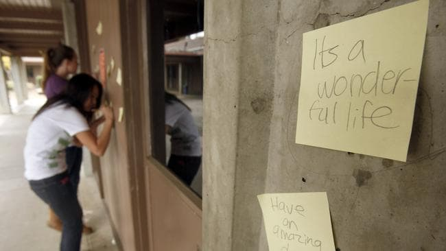 Fightback: Henry M. Gunn High School students stick Post-it notes with messages around their school after three Gunn students committed suicide. Picture: Tony Avelar/AP