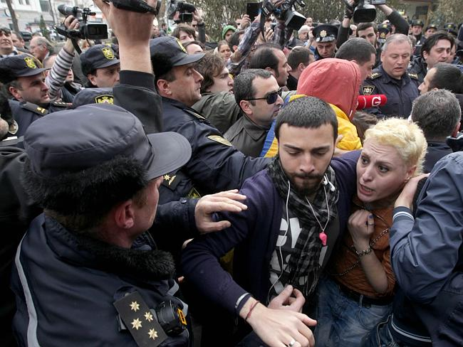 Boiling point ... police officers separate pro-Russian activists and anti-Russian activists to prevent their clashes as they rally in Tbilisi.