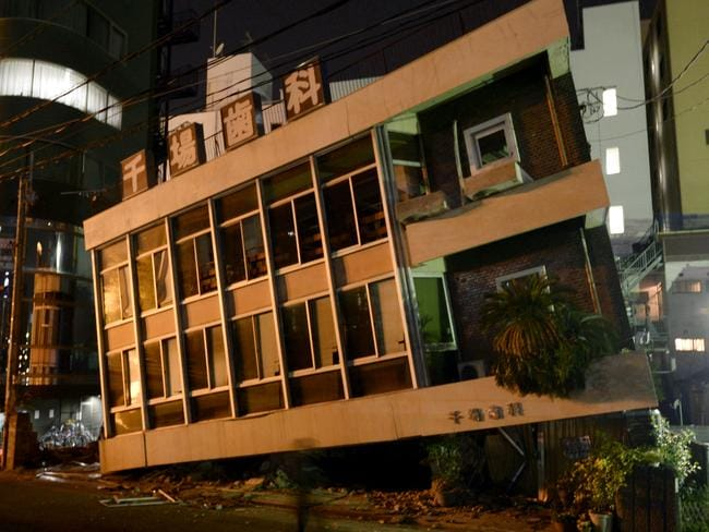 A severely damaged dentist office leans to one side following the 7.0 magnitude earthquake in Kumamoto, southern Japan. Picture: Koji Harada/Kyodo News.