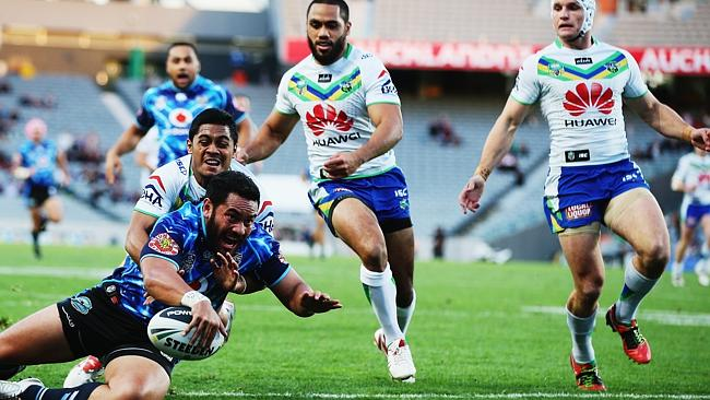 Konrad Hurrell dives over to score against the Raiders.