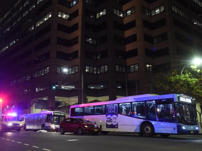 Police allege the driver had been working about 21 hours without a break when his passenger stepped out into the path of a bus. Picture: Gordon McComiskie