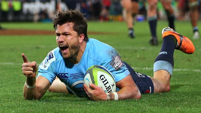 Adam Ashley-Cooper celebrates scoring his second try.