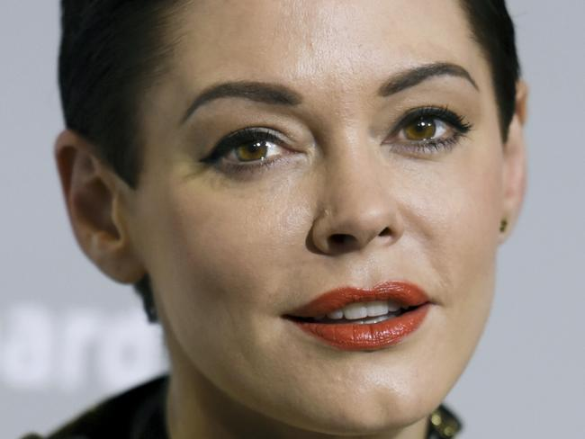 """FILE - In this April 15, 2015 file photo, Rose McGowan arrives at the LA Premiere Of """"DIOR & I"""" held at the Leo S. Bing Theatre on Wednesday, April 15, 2015, in Los Angeles.  McGowan's Twitter account has been suspended, temporarily muting a central figure in the allegations against Harvey Weinstein. McGowan said late Wednesday, Oct. 11, 2017,  that Twitter had suspended her from tweeting after the social media company said she broke its rules.(Photo by Richard Shotwell/Invision/AP)"""