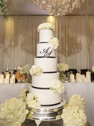 The couple's gorgeous wedding cake amid the floral scheme.