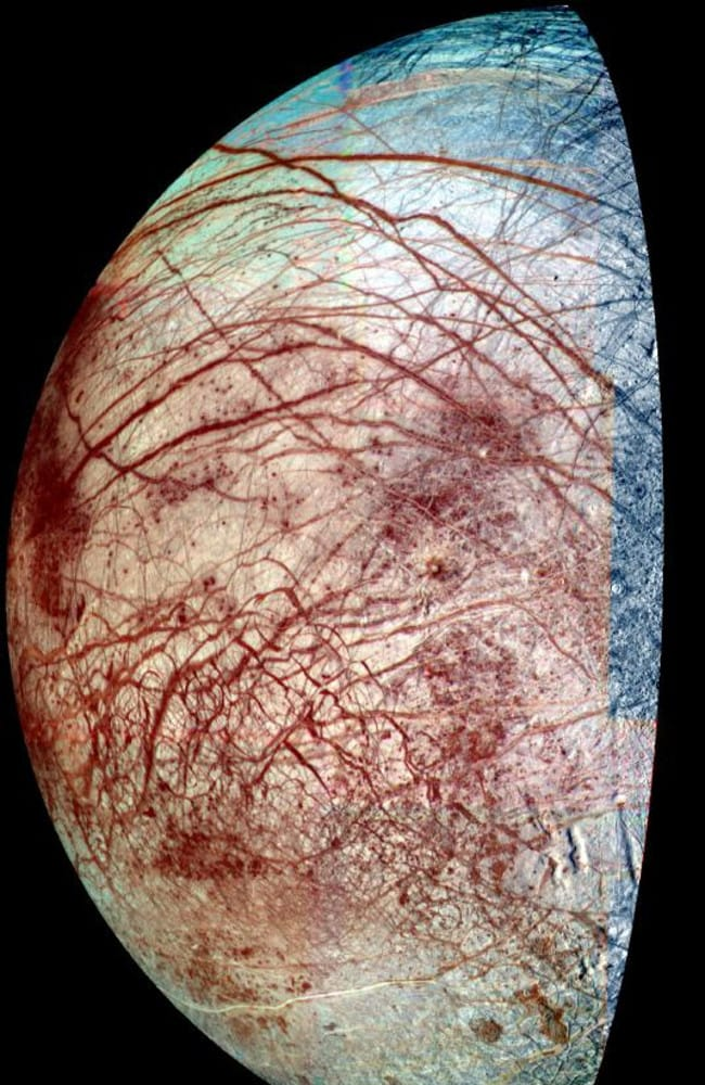 "Europa's hidden ice chemistry ... The icy surface of Europa is shown strewn with cracks, ridges and ""chaotic terrain,"" where the surface has been disrupted and ice blocks have moved around. Picture: NASA/ Flickr"