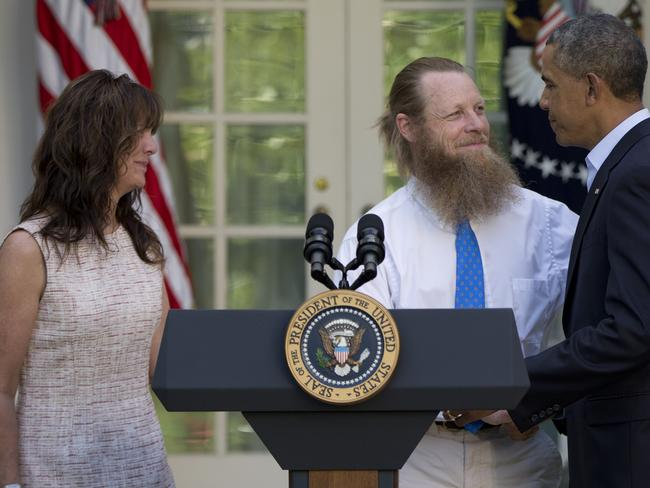 In hiding ... US President Barack Obama shakes hands with Bowe Bergdahl's parents Bob Bergdahl and Jani Bergdahl.