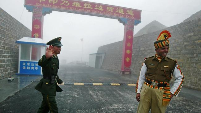 A Chinese and Indian soldier at the Nathu La border crossing between India and China in India's northeastern Sikkim state. Picture: AFP.