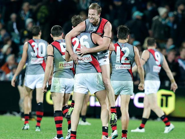 Jason Winderlick and Cale Hooker celebrate Essendon's two-point win. Picture: Sarah Reed