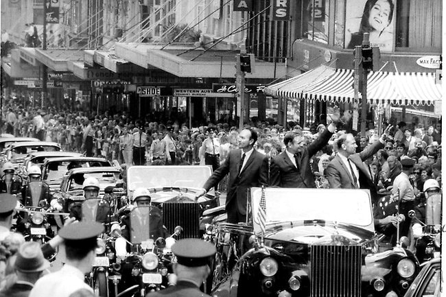 Astronauts Edwin (Buzz) Aldrin, Neil Armstrong & Michael Collins cheered by thousands as they were driven down King Street, Sydney during their triumphant visit in 1969. Picture: William Russell