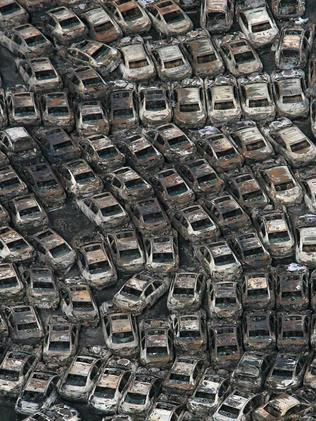 Cars burnt out by fires triggered by the tsunami lined up in Hitachinaka, three days after the tsunami. Pic: AFP/Noboru Hashimoto.