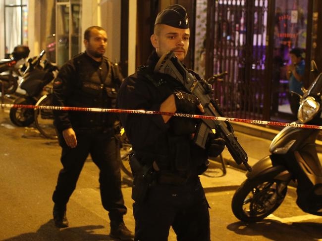 A police officer cordons off the area after a knife attack in central Paris. Picture: AP Photo/Thibault Camus