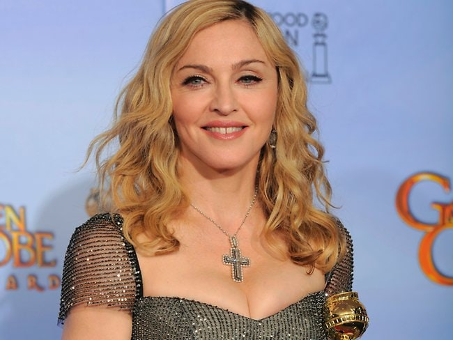 Madonna's 'squooby' pose with her Golden Globe award helped set the trend. Picture: AP