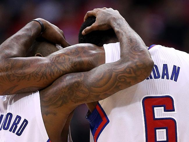 Buyout interest ... Jamal Crawford #11 and DeAndre Jordan #6 of the Los Angeles Clippers embrace during the final minute against the Golden State Warriors on Tuesday night after a big week off the court.