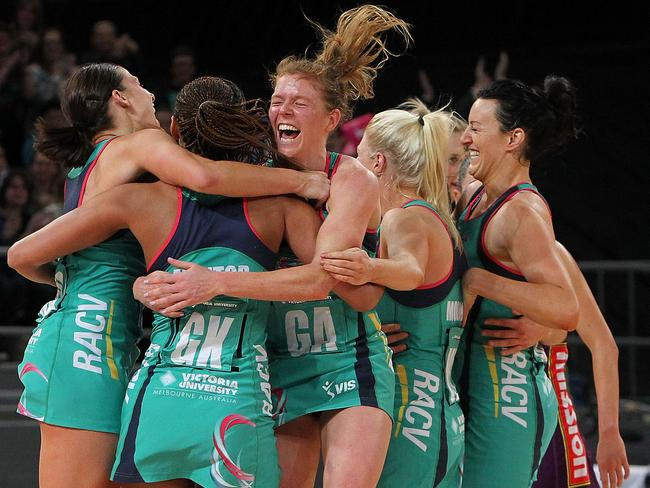 Vixens MVP Tegan Caldwell (centre) embraces her teammates following their victory against the Firebirds in the ANZ Championship grand final. Picture: Getty Images