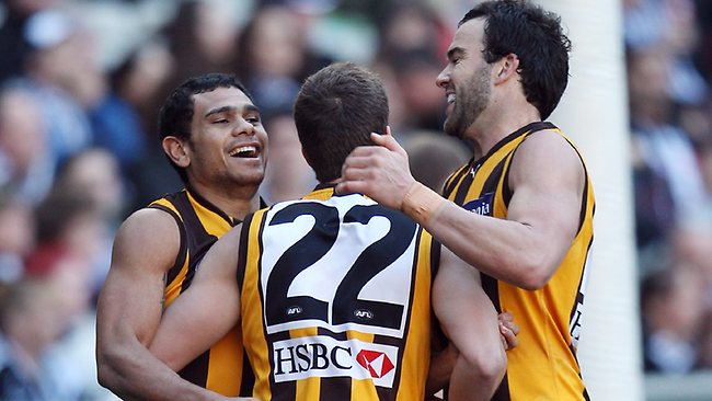 Luke Breust celebrates a snapped goal with Jordan Lewis and Cyril Rioli. Picture: Michael Klein