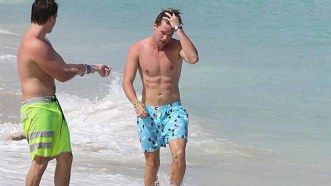 Patrick Schwarzenegger shows off his beach body.