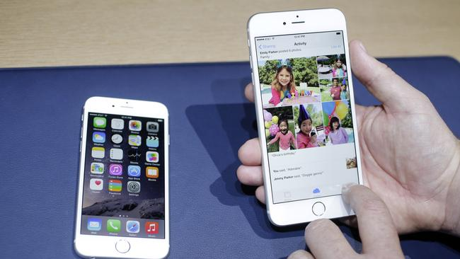 Handy ... the 5.5-inch iPhone 6 Plus will be a stretch for people with small hands. Pic: AP Photo/Marcio Jose Sanchez