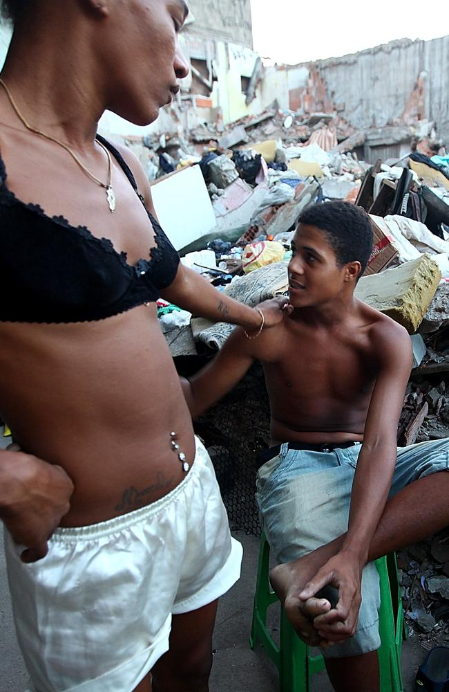 A man and woman gather next to the remains of demolished homes in the Metro Mangueira favela, located near Maracana stadium, on May 21, 2014 in Rio de Janeiro, Brazil. The homes were thought to have been knocked down for a parking lot for the stadium, though that has yet to be built.