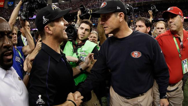 Head coach John Harbaugh of the Baltimore Ravens shakes hands with his brother head coach Jim Harbaugh of the San Francisco 49ers after winning Super Bowl XLVII.