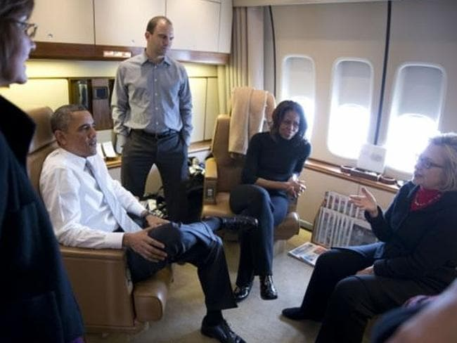 The Obamas and Hillary Clinton catch up onboard Air Force One. Picture: Pete Souza / Official White House Photo