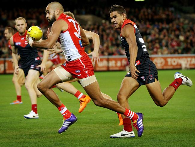 Neville Jetta is pursuit of cousin Lewis Jetta in Round 6. Picture: Colleen Petch.