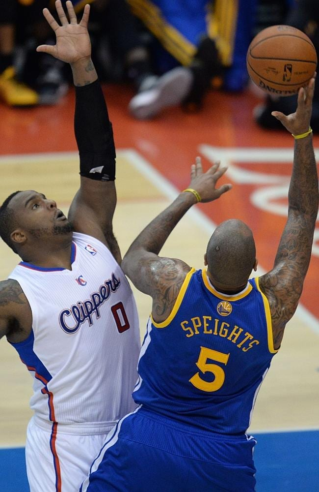 Glen Davis (L) of the Los Angeles Clippers defends against Marreese Speights (R) of the Golden State Warriors.