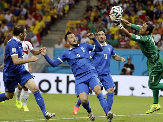Costa Rica's goalkeeper Keylor Navas, right, makes a save against Greece. He couldn't stop the equaliser.