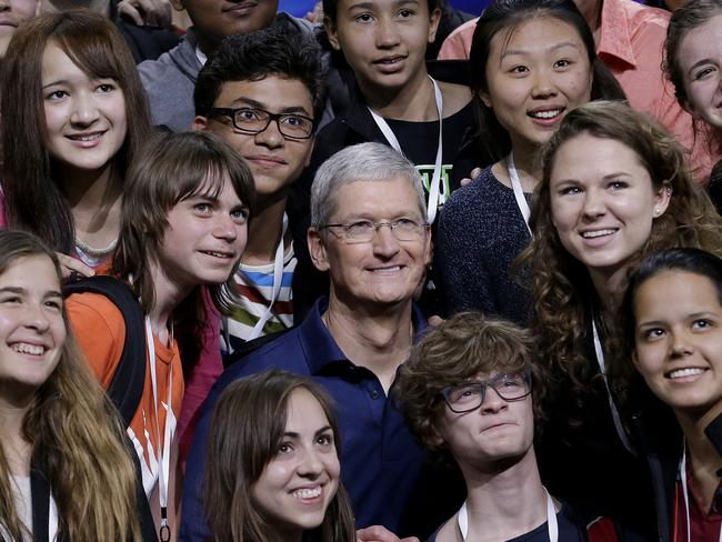 Apple chief executive Tim Cook — pictured, at centre, at the Apple Worldwide Developers Conference in June — says record numbers of smartphone users are switching to the iPhone. Picture: Jeff Chiu