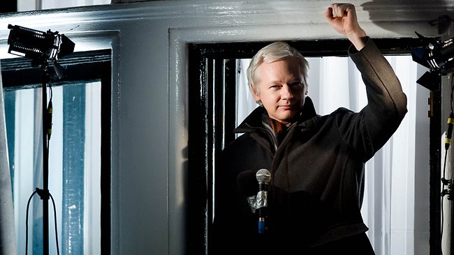 "Wikileaks founder Julian Assange gestures as he addresses members of the media and supporters from the window of the Ecuadorian embassy in Knightsbridge, west London on December 20, 2012. WikiLeaks will release one million documents next year affecting every country in the world, founder Julian Assange said in a speech from the balcony of the Ecuadorian embassy in London. In a ""Christmas message"" marking six months since he sought asylum in the embassy to avoid extradition to Sweden over claims of rape and sexual assault, Assange also said the door was open to negotiations. AFP PHOTO/Leon Neal"