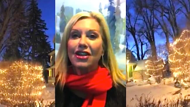 Olivia Newton-John also appears in the festive clip.