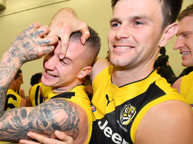 Dustin Martin of the Tigers celebrates in the change room with team mates after the Round 15 AFL match between the Port Adelaide Power and the Richmond Tigers at Adelaide Oval in Adelaide, Saturday, July 1, 2017. (AAP Image/David Mariuz) NO ARCHIVING, EDITORIAL USE ONLY