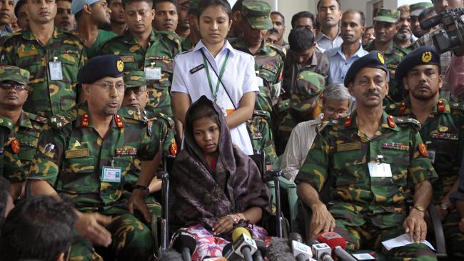 Reshma Begum, the 19-year-old seamstress who spent 17 days trapped in the rubble of a collapsed factory building talks to the media. (AP Photo/A.M. Ahad)