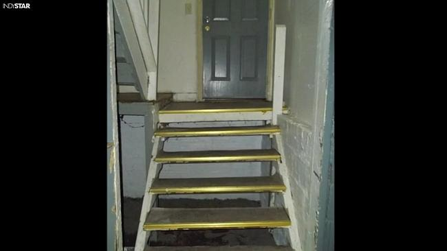 The basement door of Ms Ammons' home would creak open but no one was there. Screengrab via Indy Star