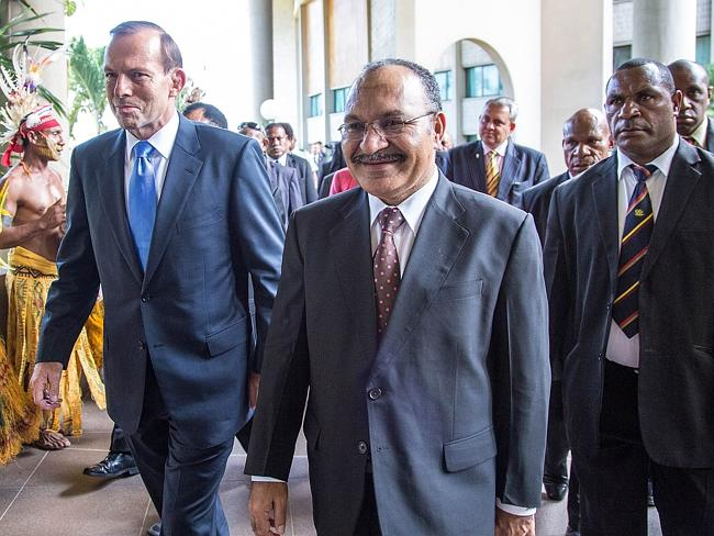 Australian Prime Minister Tony Abbott with his Papua New Guinea's counterpart Peter O'Nei