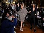 PARIS FASHION WEEK 2014: Joan Smalles and Cara Delevigne walk the runway during the Stella McCartney show. Picture: Getty