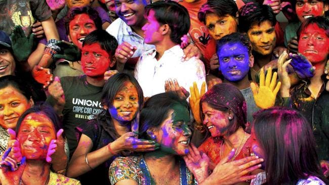 Students smear color powder on each other during a celebration ahead of Holi festival in Indore, India, Monday, Feb. 22, 2010. (AP Photo) ** INDIA OUT **