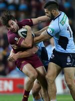 Queensland's Aidan Guerra is tackled by NSW forward James Tamou in State of Origin III.