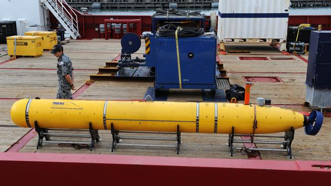 No sign of the plane ... specialists prepare to launch the Phoenix Autonomous Underwater Vehicle 'Artemis' Bluefin-21 from the vessel Ocean Shield.