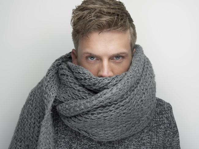 This man's scarfwear matches both his knitwear and his cold, steely eyes. In other words, he's a bit of a tosspot.